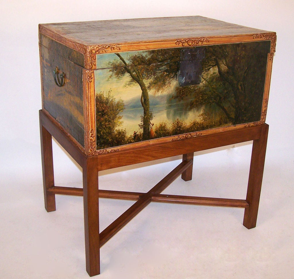 An unusual Chinese pigskin leather trunk, beautifully hand-painted on five sides with pastoral scenes, most likely painted by an American or European. The stand is newly custom-made for this trunk. Height will work as a side or end table. China,
