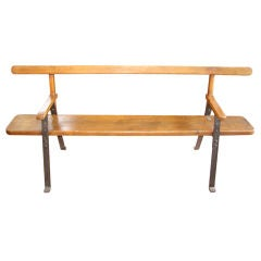 Wood plank and iron support bench
