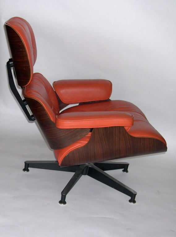 original eames 670 lounge chair and 671 ottoman in coral