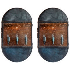 Pair of large patinated bronze industrial sconces