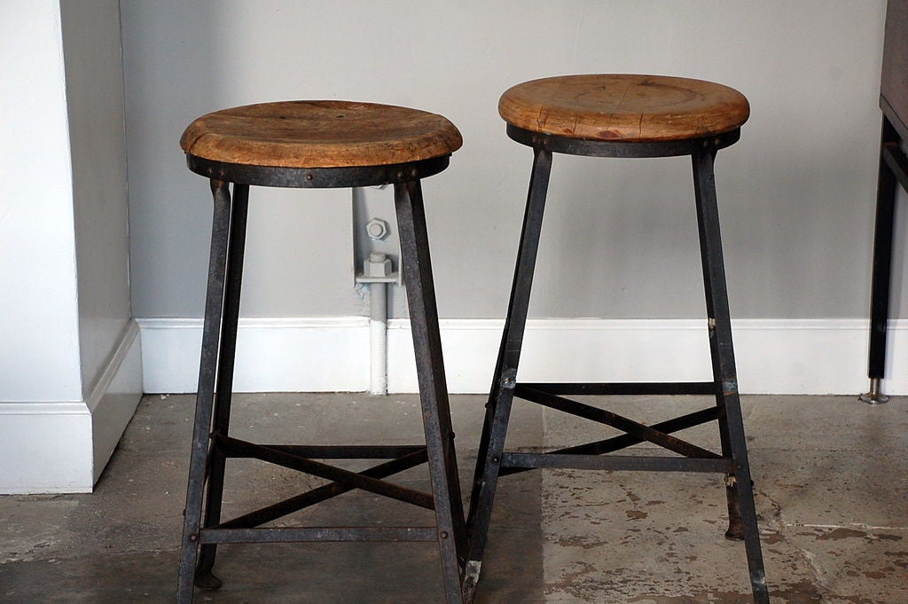 This pair of steel and oak industrial bar stools is no longer