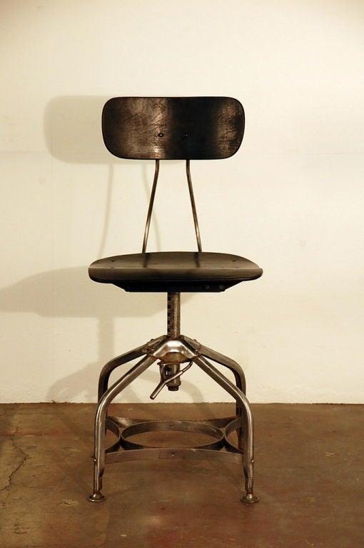 Polished steel and ebonized wood toledo drafting stool at