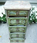 Continental diminutive painted chest. Gray veined marble top with canted corners, resting on the conforming case, painted with colorful foliate.