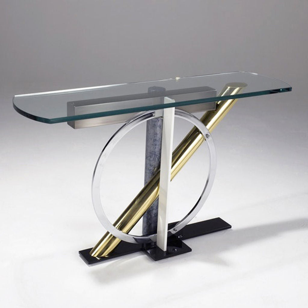 Designed by Kaizo Oto for DIA, mixed metal console with glass top, geometric base in enameled steel, chrome and brass. c 1980s Memphis Design, in the style of Ettore Sottsass, Italy.