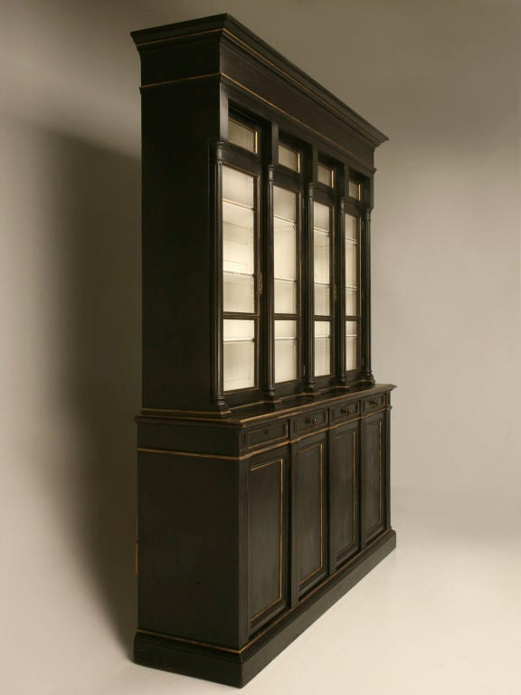 Magnificent antique French Napoleon III 8 over 8 bibliotheque/china cabinet. Finished in black with gold trim, this fluted beauty will take your breath away. It's contrasting winter white interior showcases most any collection, be it crystal, china,
