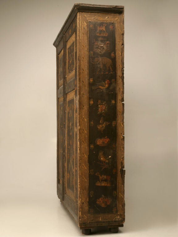 From the owner's personal collection, we have this charming antique Country English Folk Art hand-decoupaged cupboard with the original backboards attached with hand-cut nails. The interior is fitted with the original shelves and pigeon holes. Image