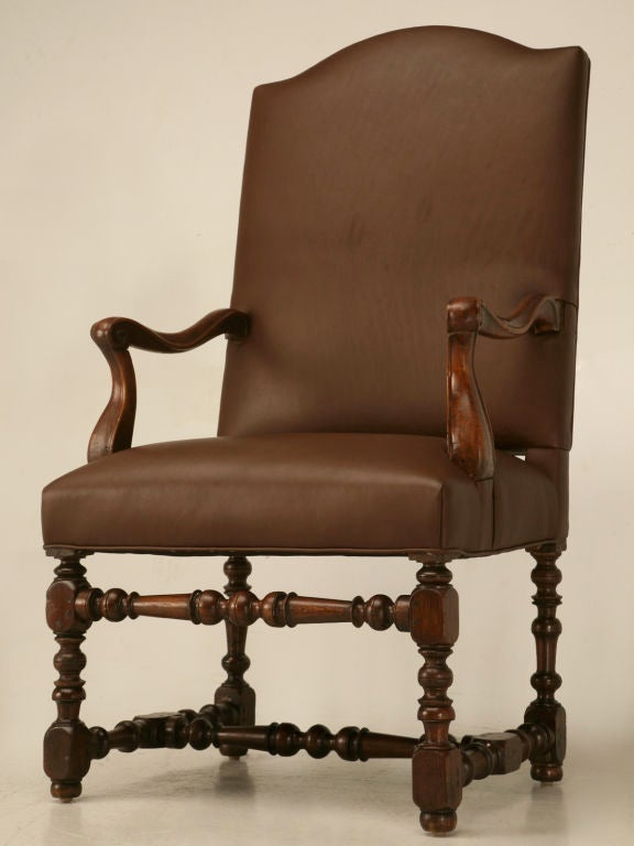 French throne chair that we completely disassembled, cleaned, glued, and reupholstered with new springs, paddings, and high quality leather. Perfect utilized as either a cozy chair in the parlor next to the fireplace for reading a good novel, or for