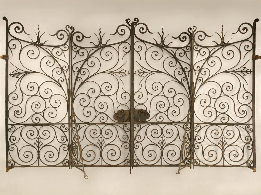 Large antique french hand wrought iron gates w sides at