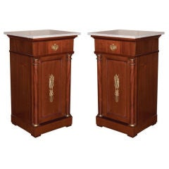 A Pair of French Mahogany Bedside Tables