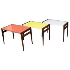 A Group of Three  Walnut Folding Tray Tables with Formica Tops