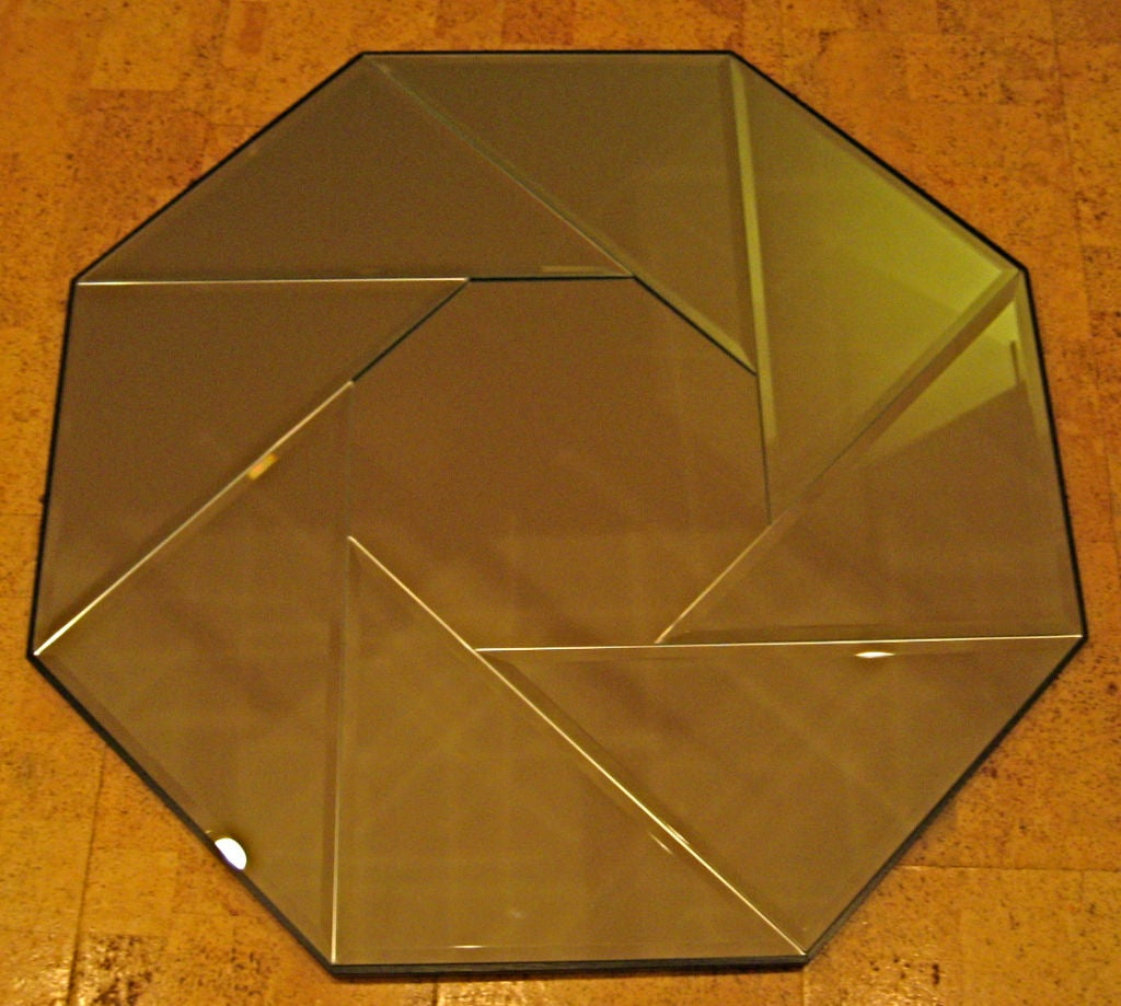 "High end Mirror consisting of a central Octagonal mirror surrounded by beveled triangles, forming a Pinwheel pattern, on a 7/8"" thick wooden substrate with chamfered top edge."
