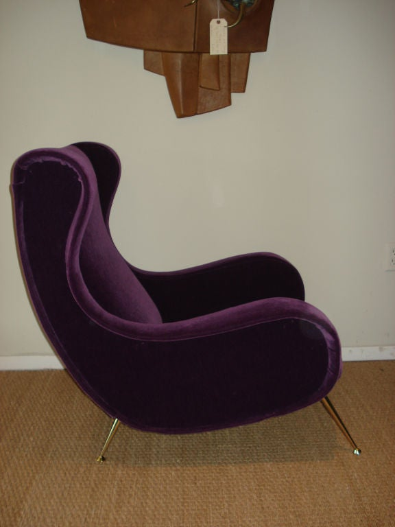 Superb Italian 1950's lounge chair, newly upholstered with a vibrant purple mohair, brass plated legs.