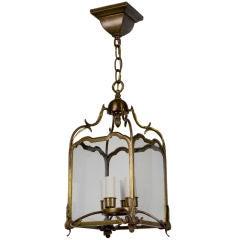 A petite antique brass lantern