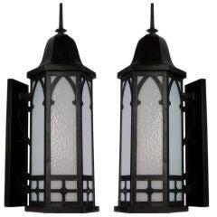 A pair of antique hexagonal exterior wall lanterns