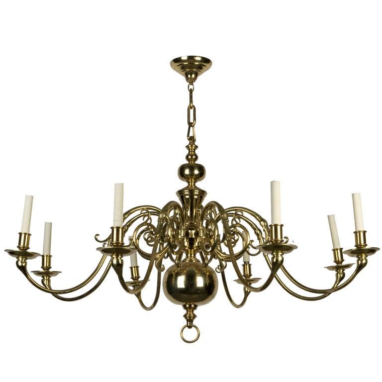 An eight light solid brass chandelier For Sale at 1stdibs