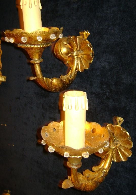 A pair of 1920s French single arm sconces with crystal beads on body, original patina.
