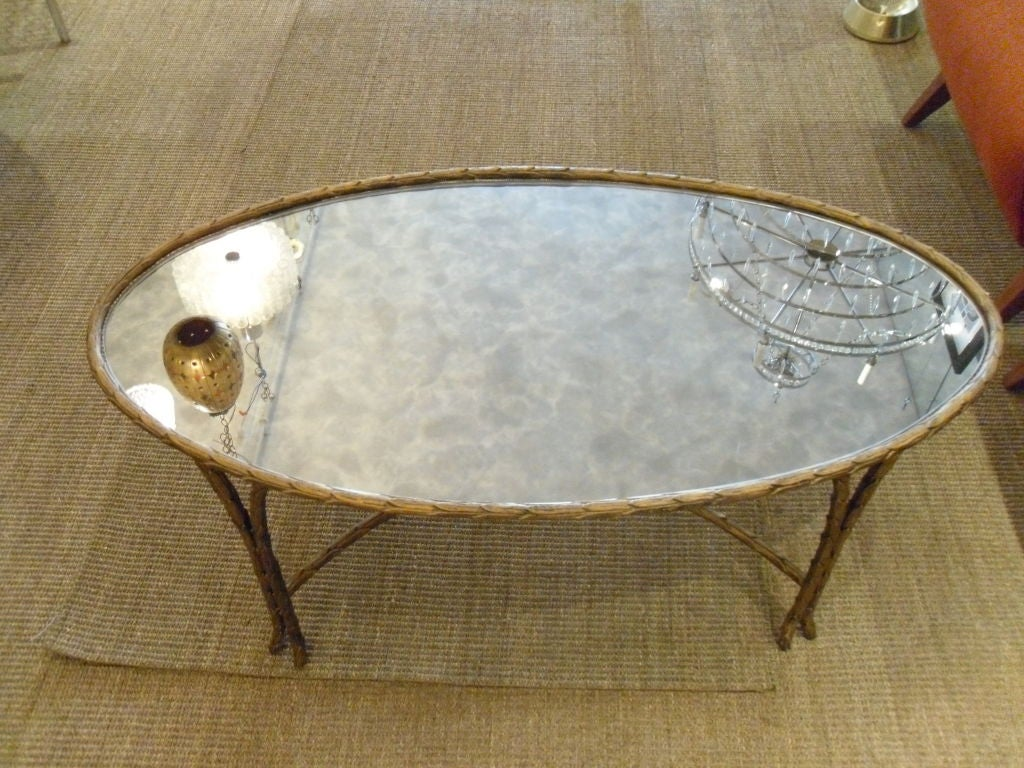 Jansen Gilt Reeded Oval Coffee Table With Mirrored Glass Top At 1stdibs