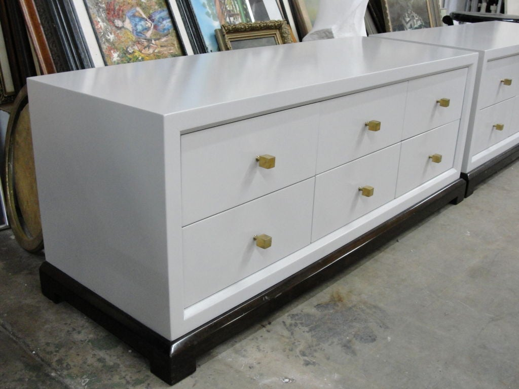 Pair of extra long low cabinets w modernist square