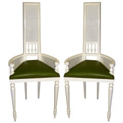 Unusually tall seat armchairs with great detail caning & leather