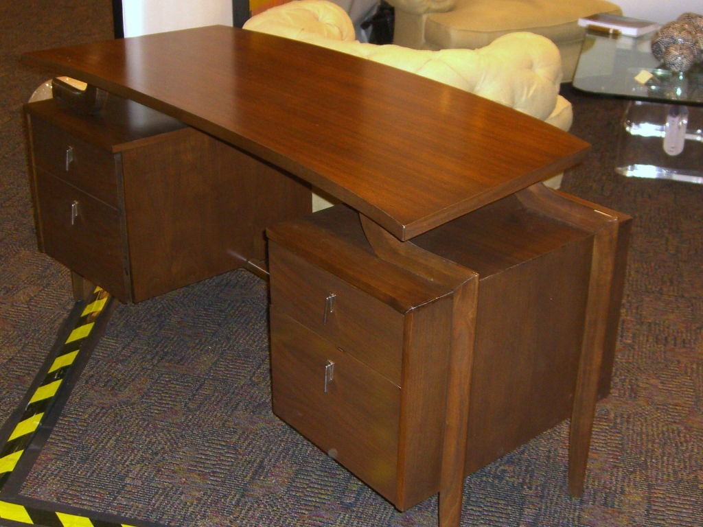 A Nicely Designed Floating Top Walnut Veneered Desk With Great Curved Supports The Label Inside