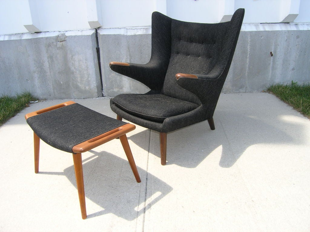 This Papa Bear chair and ottoman by Hans Wegner is in excellent all-original condition with charcoal grey wool upholstery. Ottoman dimensions - 27.5