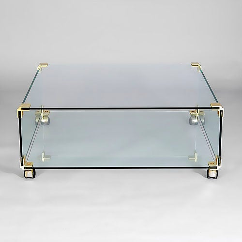 Glass Coffee Table On Casters With Brass Corner Mounts 1970s At 1stdibs