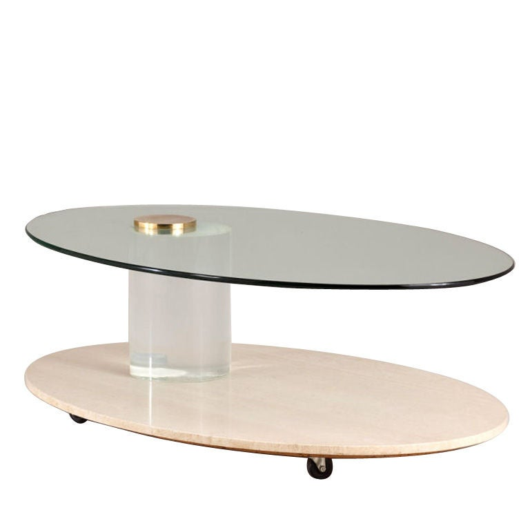 A lion in frost travertine and lucite oval shaped coffee table at 1stdibs Oval shaped coffee table