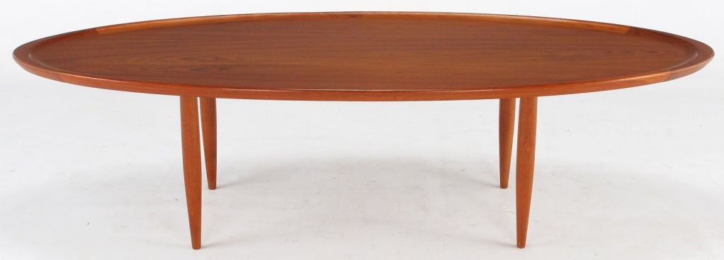 Sculpted teak wood oval tray coffee table at 1stdibs for Oval teak coffee table