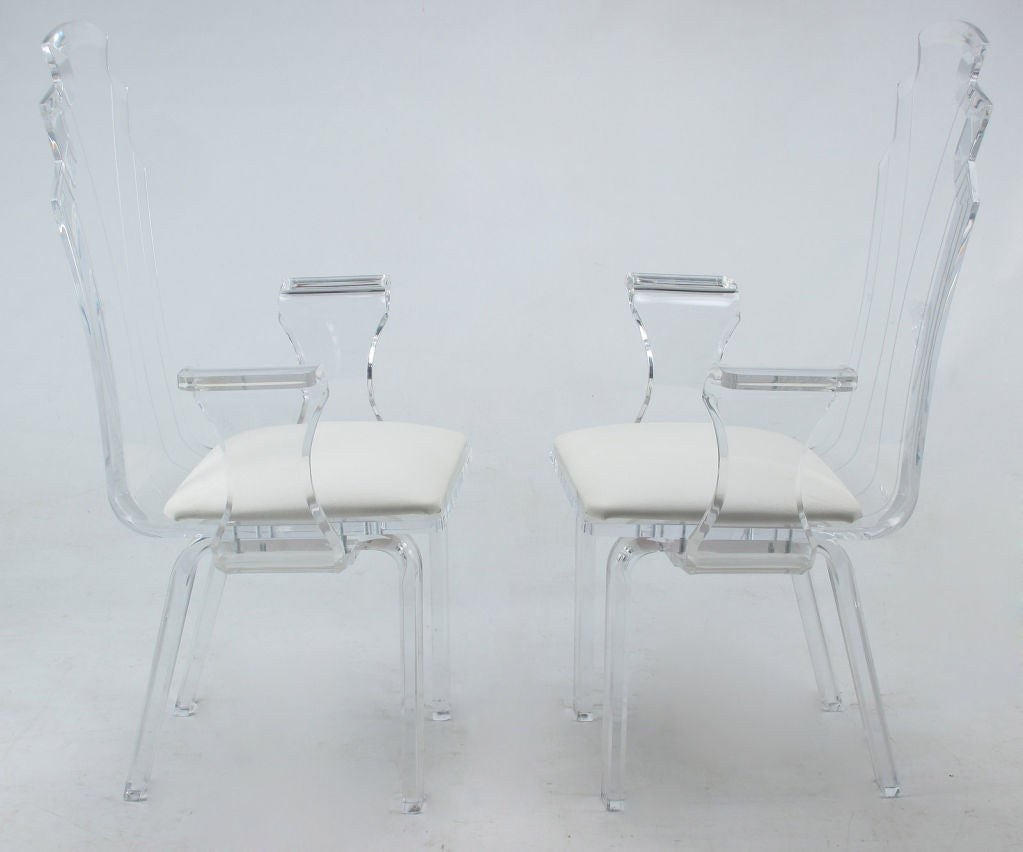 set of six lucite dining chairs with upholstered seats at