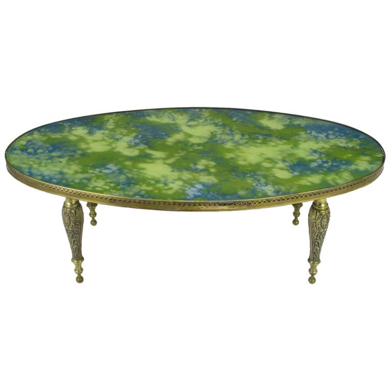 Oval Brass Cocktail Table With Reverse Painted Glass Top At 1stdibs