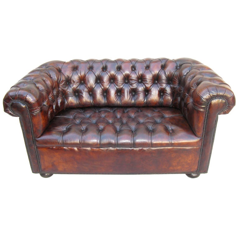 Handsome leather tufted chesterfield style small sofa c for Small tufted sofa