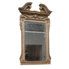 A William Kent style Period carved giltwood looking glass