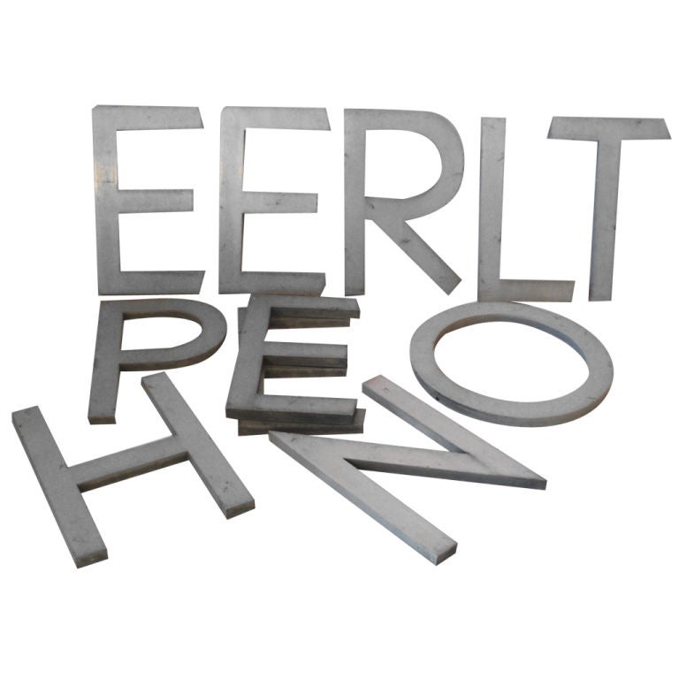 cast aluminum neutra letters g e n e r a l t e l e p h With neutra letters