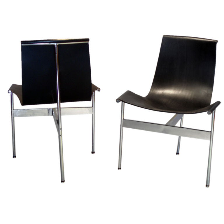 Pair Of Three Legged Black Leather Sling Chairs For