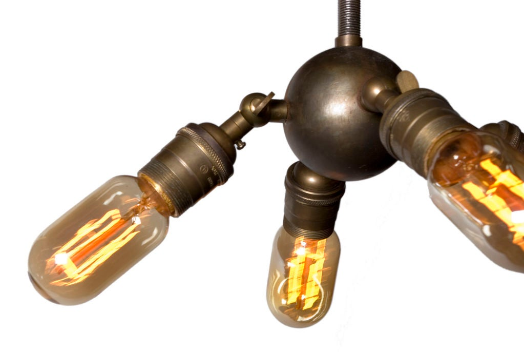 Long stem Industrial Pendant lights with four adjustable arms.<br /> Light bulbs included