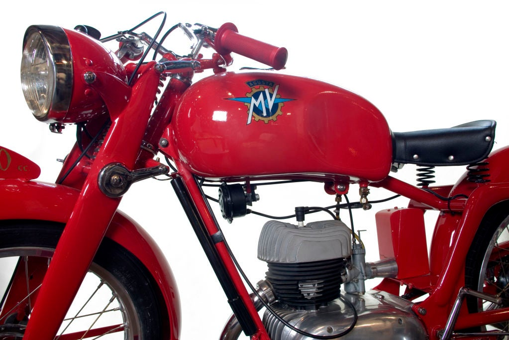 Exquisitely restored, wonderfully vibrant Italian MV Agusta Motorbike. The Agusta was lovingly restored 10 years ago in Italy by renowned restorer, Franco De Piero. The bike is a rare single stroke model that was never mass produced. It was likely