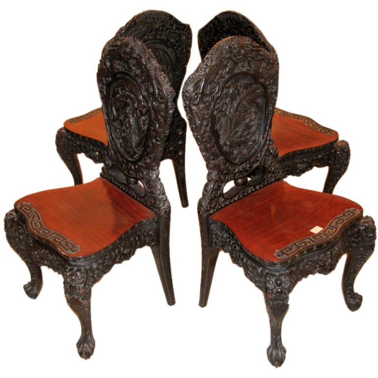 Set Of Four Handsomely Carved Wooden Hall Chairs At 1stdibs