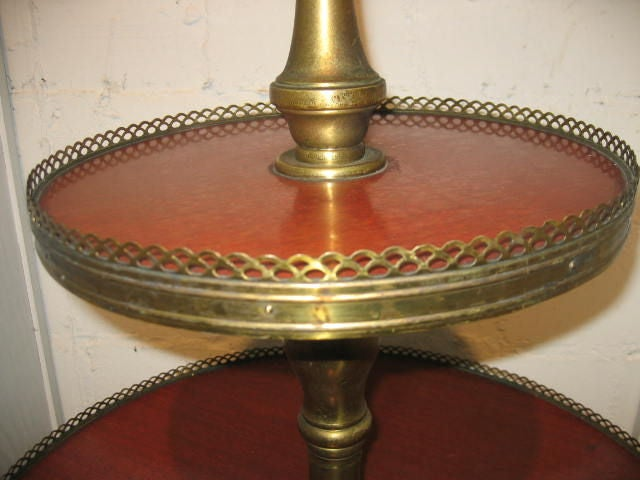 Tiered table with brass gallery.