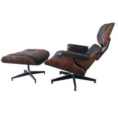 Early rosewood lounge chair and ottoman by Charles Eames