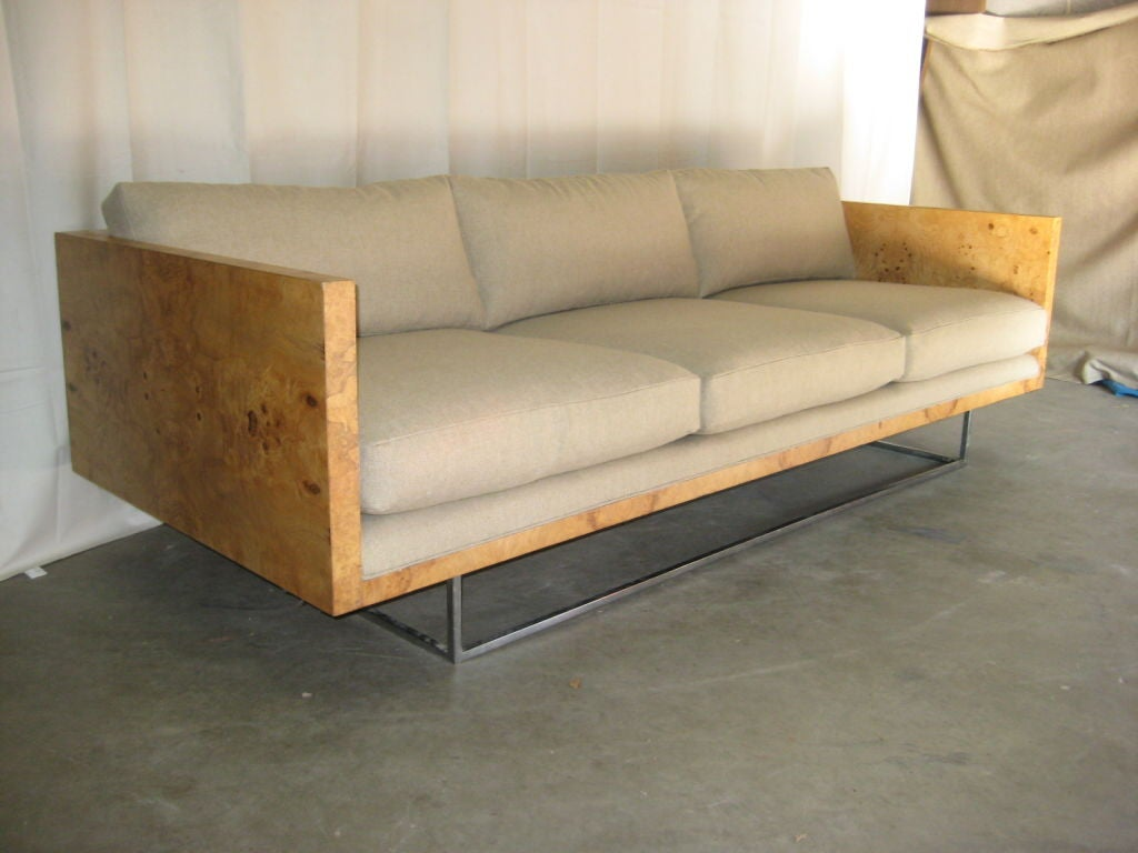 Very rare burl wood case sofa by Milo Baughman for Thayer Coggin. The sofa sits on a base made of chromed square tubing.