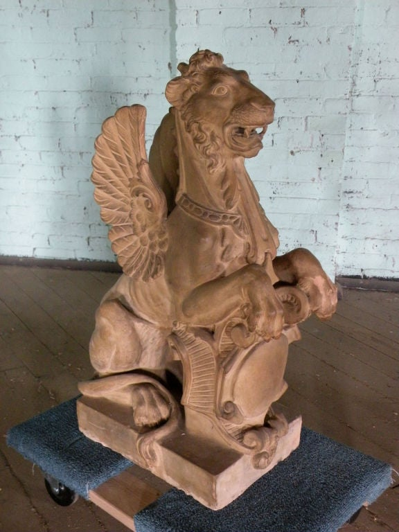 Terracotta Pair of 19th Century Terra Cotta Winged Lions For Sale