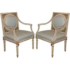 A Pair of Painted and Gilded Neoclassical Chairs