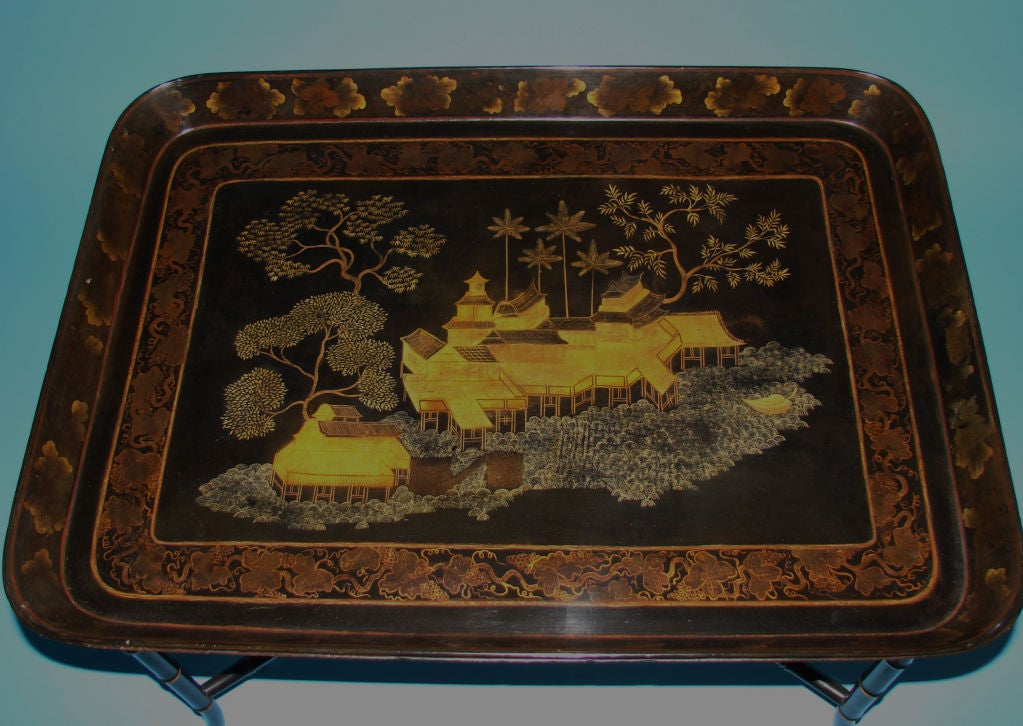 An English  papier mache tray in the Chinese taste, circa 1840,  now on a faux bamboo stand of a later date.