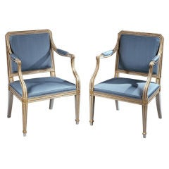 A Fine Pair of Painted and Parcel Gilt Armchairs