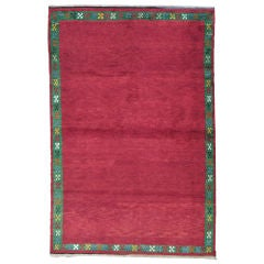 Red Tulu Rug with Green Border