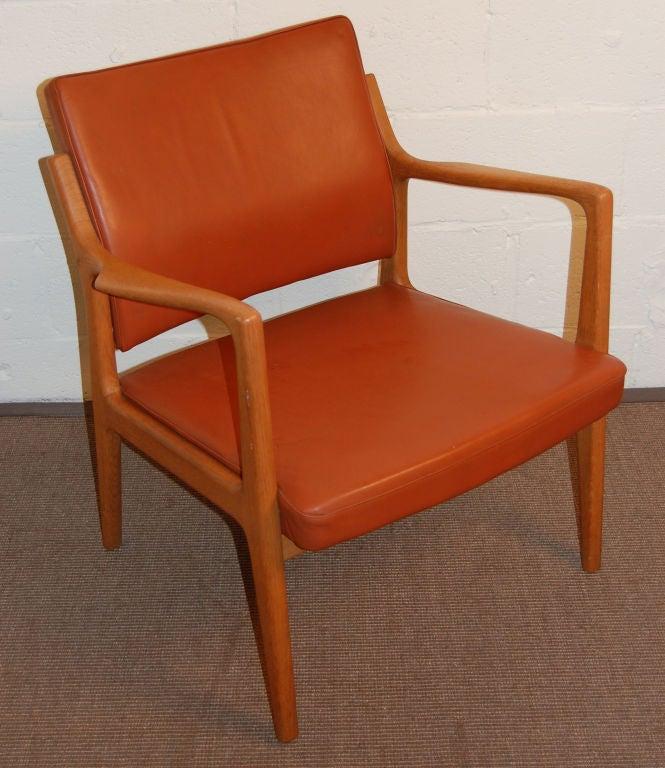 Designed by Karl-ErikEkseliusforJOCMobler, Vetlanda, Sweden. Original dark pumpkin leather on a teak frame.<br /> <br /> Overall dimensions:  25 1/2