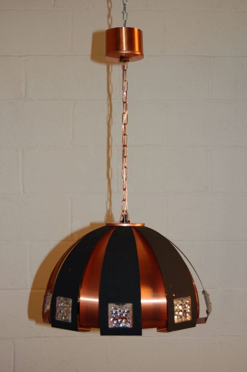 Fantastic dome pendant created by alternating strips of copper and black metal accented with bubble-glass insets.  Copper chain and canopy. Glass diffuser around socket that takes one standard bulb - up to 100 watts.