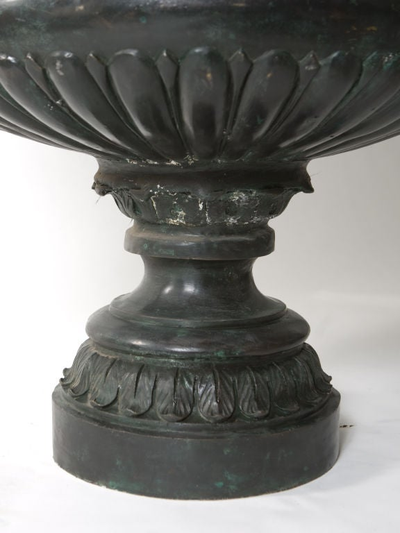 Impressive bronze garden urn with heavily carved decoration and deep patina.