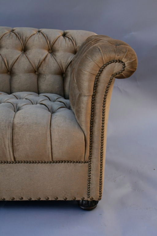 Large, freshly upholstered sofa with fine attention to detail.  Finely tufted velvet with rolled arms adorned with decorative nailhead trim over a 1920's frame.