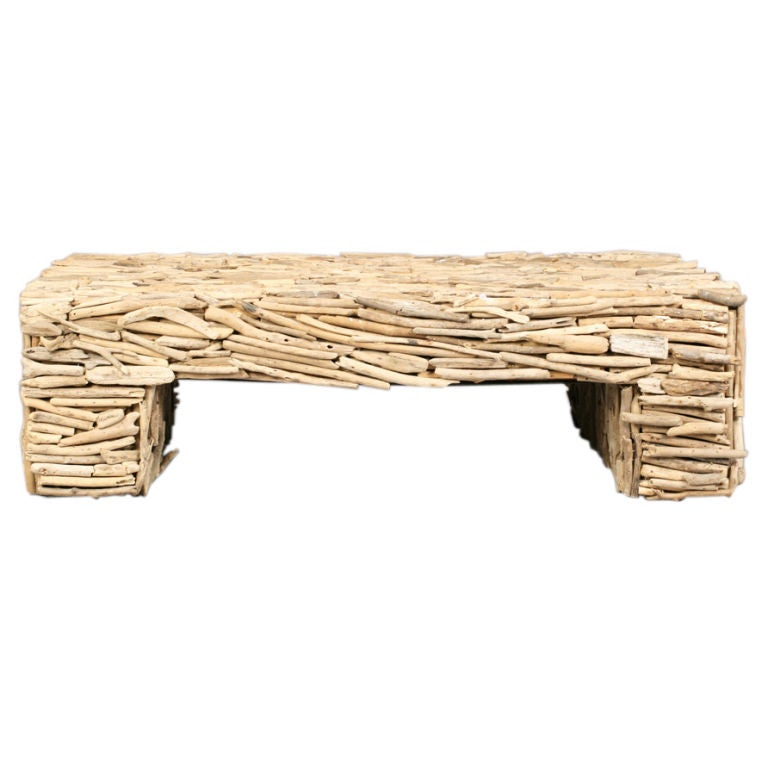 stylish coffee table covered in a collage of driftwood pieces at